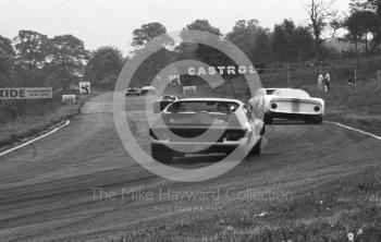 Paul Hawkins, Ford GT40, and Denny Hulme, Lola T70, lead into Island Bend, Oulton Park, Tourist Trophy 1968.