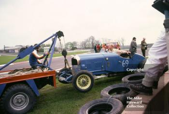T C Llewellyn's 1929 Bentley being towed away from the chicane, VSCC meeting, Donington Park, May 1979.
