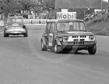 Jenny Dell, D J Bond Mini Clubman, followed by J Macdonald, Ford Anglia, Hepolite Glacier Saloon Race, Mallory Park, 1971