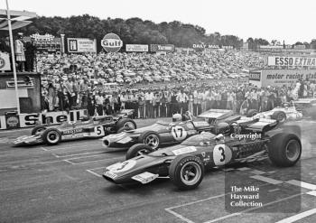 Jacky Ickx, Ferrari 312B, Jack Brabham, Brabham BT33 and Jochen Rindt, Lotus 72C, lead off the grid at the start of the 1970 British Grand Prix at Brands Hatch.