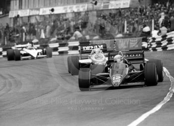 Ayrton Senna, JPS Lotus 97T-4, leads Keke Rosberg, Williams FW10/7, through Paddock Bend, 1985 European Grand Prix, Brands Hatch