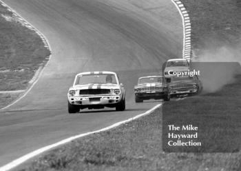 Jack Oliver, Ford Mustang, leads out of Paddock Bend, British Touring Car Championship Race, Guards International meeting, Brands Hatch 1967.
