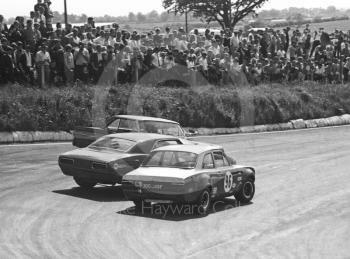 Dennis Leech, Ford Falcon Sprint, spins at Shaw's Hairpin, eliminating Roy Pierpoint, Chevrolet Camaro, and Frank Gardner, Alan Mann Ford Escort Twin Cam (XOO 349F), British Saloon Car Championship race, BRSCC Guards 4,000 Guineas International meeting, Mallory Park, 1969.
