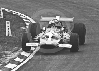John Surtees lifts a wheel at Paddock Bend, McLaren M7C, Formula One Race of Champions, Brands Hatch, 1970