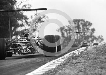 Graham Hill, Lotus Cosworth V8 49B R5, leads team mate Jackie Oliver out of South Bank Bend, British Grand Prix, Brands Hatch, 1968.