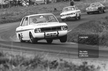 Jacky Ickx, Team Lotus Cortina, CTC 24E, on three wheels, leads team mate Graham Hill, CTC 14E, on two wheels, Oulton Park Gold Cup meeting, 1967.