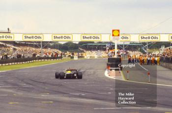 Nigel Mansell, Williams F11B,  takes the chequered flag, Silverstone, 1987 British Grand Prix.