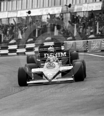 Keke Rosberg, Williams FW10/7, leads Ayrton Senna, JPS Lotus 97T-4, through Paddock Bend, 1985 European Grand Prix, Brands Hatch