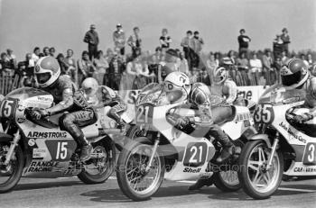 Clive Horton, 250cc Armstrong, and Tom Drury, 250cc Yamaha, leave the grid at the John Player International Meeting, Donington Park, 1982.