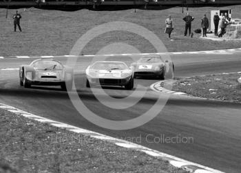 Bill Bradley/Eric Liddell Porsche 906 leads the winning JW Ford GT40 of JackyIckx/Brian Redman and the 5th place Pedro Rodriguez/ Roy Pierpoint Ferrari 250LM at South Bank Bend, 1968 BOAC 500, Brands Hatch