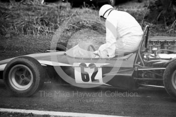 Peter Blankstone climbs from the cockpit of his Brabham Quattro 4WD, Loton Park, April 27, 1969.