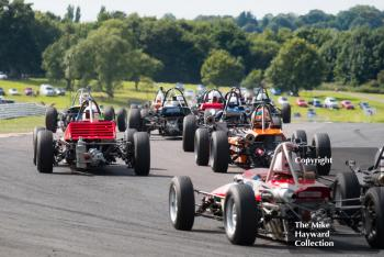 Formula Fords swarm out of Old Hall at the 2017 Gold Cup, Oulton Park.