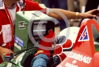Teo Fabi, Benetton B187, checks lap times in the pits, British Grand Prix, Silverstone, 1987