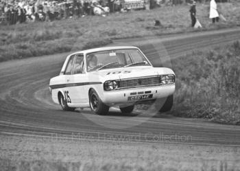 Graham Hill, Team Lotus Cortina, CTC 14E, at Cascades Bend, before retiring one lap from the finish, Oulton Park Gold Cup meeting, 1967.