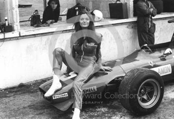 A model poses on the Ferrari V12 312 0011 of Chris Amon in the pit lane during practice, British Grand Prix, Brands Hatch, 1968.