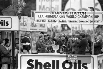 Nigel Mansell and Ayrton Senna celebrate on the podium, Brands Hatch, 1985 European Grand Prix.