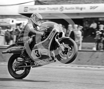 Randy Mamola pops a wheelie on his 500cc Suzuki at the John Player International Meeting, Donington Park, 1982.