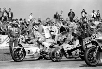 Randy Mamola, 500cc Suzuki, and Barry Sheene, 500cc Yamaha, leave the grid at the John Player International Meeting, Donington Park, 1982.