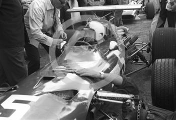 Chris Amon in the pits with his Ferrari 312 0011 V12 during practice for the 1968 British Grand Prix at Brands Hatch.