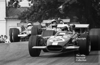 Keith Holland, Alan Fraser F5000 Lola T142, followed by Mike Walker, Alan McKechnie F5000 Lola T142, and Trevor Taylor, Surtees TS5, at Lodge Corner, Oulton Park Gold Cup 1969.