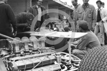 Activity in the Brabham and Ferrari pits during practice for the 1968 British Grand Prix at Brands Hatch.