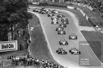 Elio de Angelis, JPS Lotus 97T-3, and Nigel Mansell, Williams FW10/6, lead the pack out of Druids Hairpin, Brands Hatch, 1985 European Grand Prix
