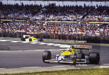 Nelson Piquet and Nigel Mansell, Williams FW11B, at Copse Corner during their battle for the lead, won by Nigel, British Grand Prix, Silverstone, 1987